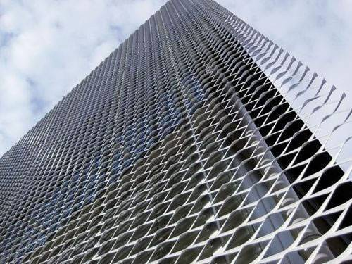Galvanized aluminum expanded metal meshes with diamond holes are installed on the facades of office Building.